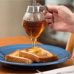 Dávkovač na med